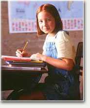 Girl at school desk